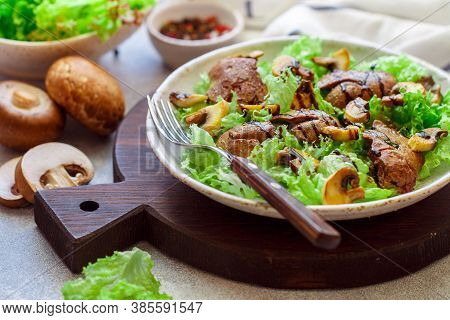 Warm Lettuce Salad With Chicken Liver, Fried Mushrooms, Olive Oil, Seasonings And Balsamic. Deliciou