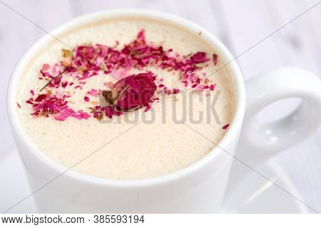 tasty cappuccono with rose petals