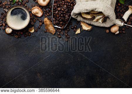 Mushroom Chaga Coffee Superfood Trend-dry and fresh mushrooms and coffee beans on dark background