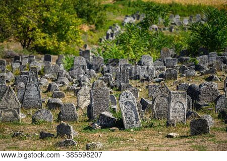 Vadul Rascov, Soldanesti, Moldova, September 2020: Old ruined tombstones at the ancient Jewish cemetery, now abandoned. Jewish communuty was massacred by nazis during WW2.
