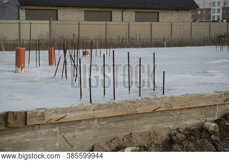 House Foundation Made From Concrete Shuttering Blocks Filled With Mortar And Reinforcement Bars. Con