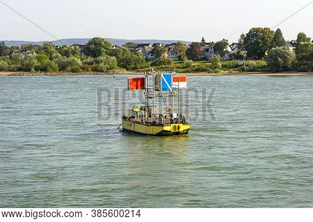 A Yellow Floating Platform On The River With Inland Prohibitory And Mandatory Signs.