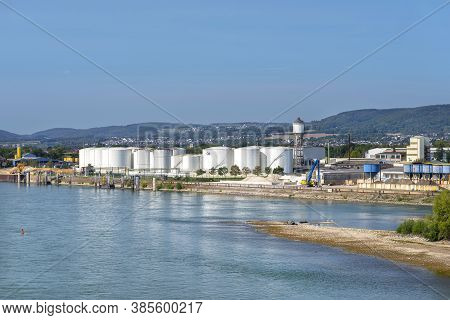 Storage Silos,fuel Depot Of Petroleum And Gasoline On The Banks Of The River In Western Germany On A