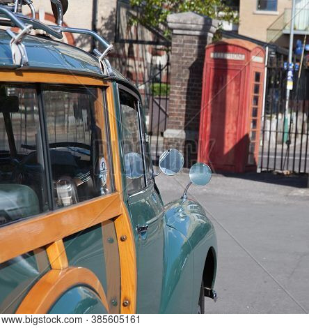 A Morris Minor Car Parked By A Red Phone Box In The Uk, Taken On The 20th July 2020 In Dorchester, D