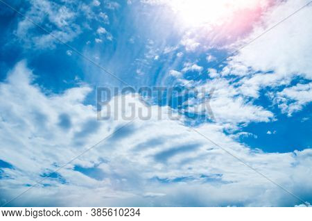 Sunset sky background. Sunset clouds lit by evening soft sunlight. Vast sky landscape panoramic scene, bright sunset sky. Vast sky landscape, panoramic sky background. Blue sky scene