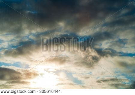 Sunset sky background. Sunset golden dramatic clouds lit by evening soft sunlight. Vast sky landscape scene, picturesque sunset sky background. Vast sky landscape scene, bright sunset sky landscape
