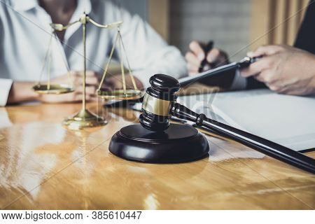 Male Lawyer Or Counselor Working In Courtroom Have Meeting With Client Are Consultation With Contrac