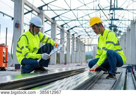 Construction Engineer Are Checking The Accuracy Of The Steel Structure Before Using The Structure Fo