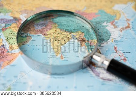 Bangkok, Thailand - August 01, 2020 India, Magnifying Glass Close Up With Colorful World Map, Magnif