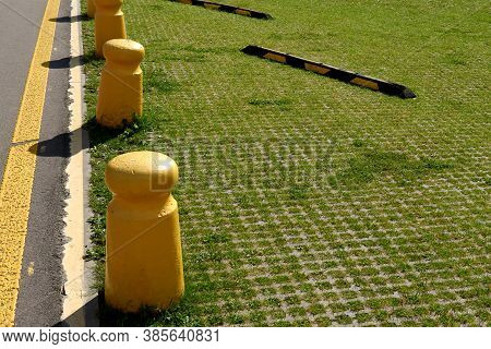 Ecological Parking For Cars And A Green Grass. Eco Friendly Parking Lane Outdoor In Public Park
