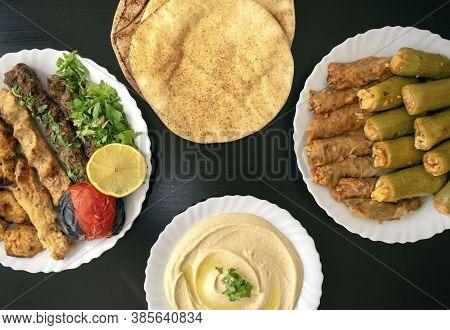 Famous Traditional Arabic, Turkish, Israel Food. Grilled Chicken, Kofta Kebab, Mahshi, Cabbage Rolls