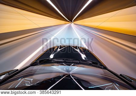 View From Roof Of Car Moving In A Night City, Blured Road With Lights With Car On High Speed. Concep