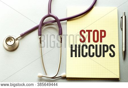 On A Purple Background A Stethoscope With Yellow List With Text Stop Hiccups
