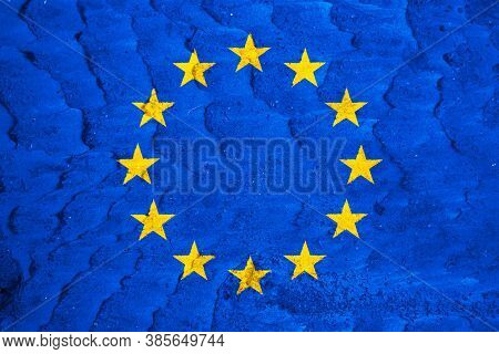 Eu Flag On Texture Background. Background For Greeting Cards For Eu Public Holidays. Europe Day Is C