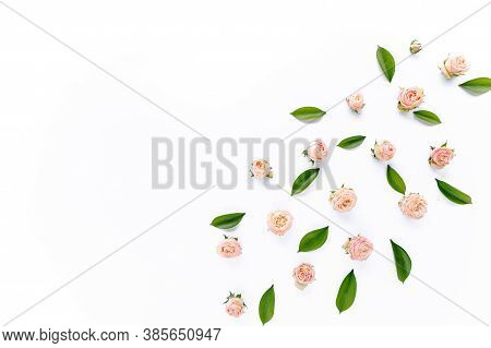 Floral Pattern Made Of Pink Roses, Green Leaves, Branches On White Background. Flat Lay, Top View. V