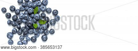 Blueberries Background. Fresh Juicy Blueberries With Green Leaves On White Background. Flat Lay Top