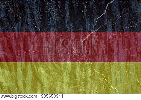 German Flag On Wooden Surface. German Flag On Textured Background. National Flag Of Germany. Grunge
