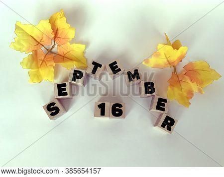 September 16 On Wooden Cubes On A White Background .calendar For September.autumn