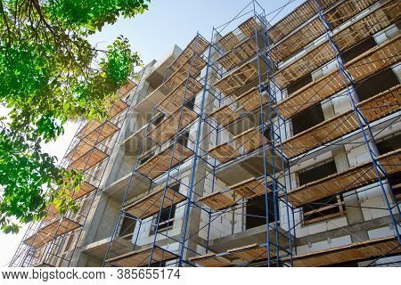 Scaffolding At A Building Under Construction. Construction And Scaffolding. Assembly Scaffolding.