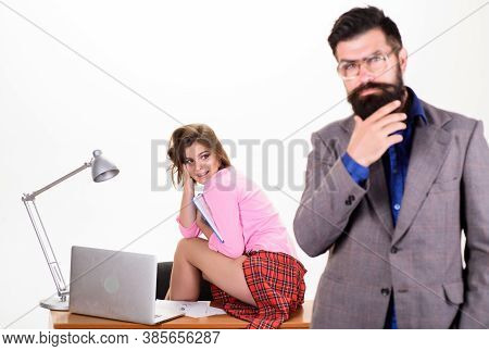 Woman Fantasizing About Coworker. Man Bearded Boss Stand In Front Of Sexy Girl Working Laptop. Offic