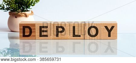 Deploy Word Written On Wooden Cubes, Concept