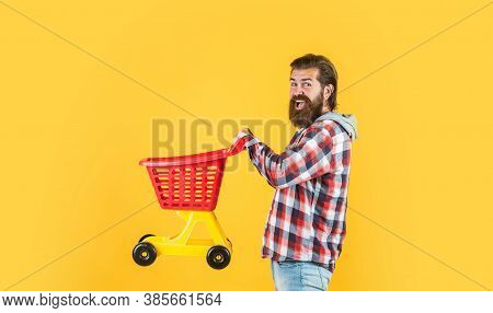 Man Go Shopping. Funny Man With Small Shopping Cart. Weekend On Buying Products. Rejoices Successful