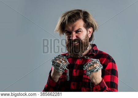 Man Has Heavy Steel Chain On Neck. Conceptual Symbol Of Freedom. Male Fashion. Strong Man With Chain