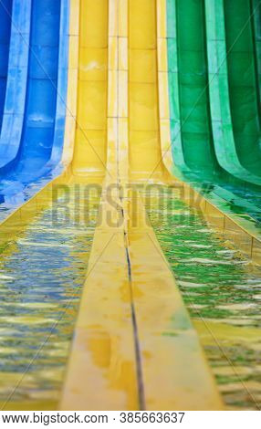 water slides in tropical waterpark on a sunny day