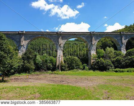 Cement Train Bridge Outside Of Brad Town, Romania. Abandoned Viaduct Cement Bridge For Train Archite