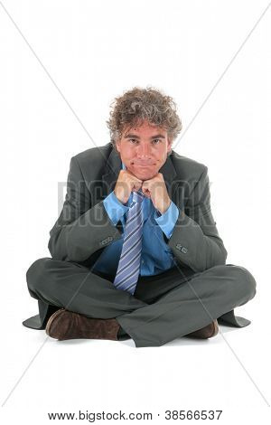 Aggrieved business man sitting at the floor