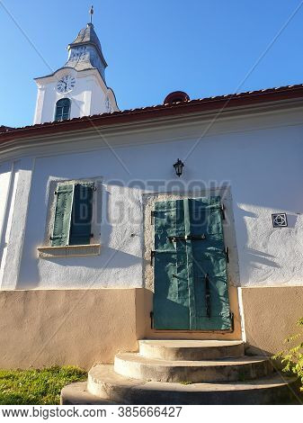 Closed Metallic Window Shutters And Gate In Rimetea, Romania. Architecture Detail Of Unitarian Churc