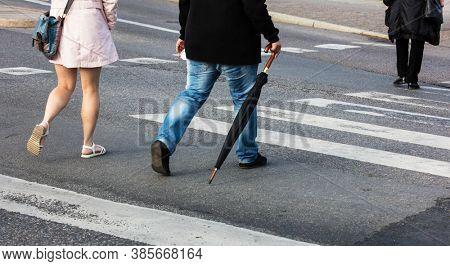 couple walking on a pedestrian crossing
