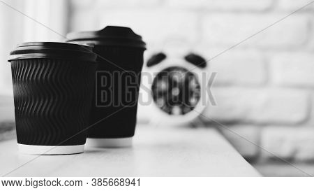 Cappuccino In A Glass In Black And White Colors,close-up,on The Background Retro Clock,brick Wall,cl