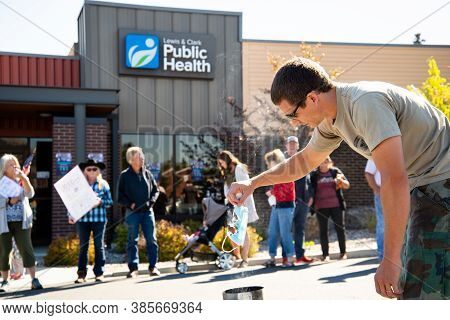 Helena, Montana / September 11, 2020: Protester Burns Mask At Mask Protest In Front Of Public Health