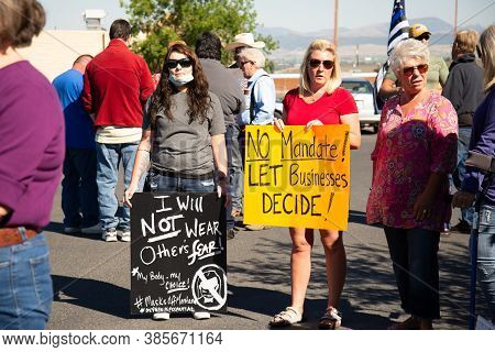 Helena, Montana / September 11, 2020: Protesters Hold Signs At Mask Protest, Protesting Mask Mandate