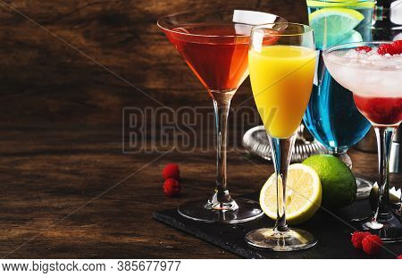 Selection Of Summer Cocktails. Cold Refreshing Alcoholic Beverages And Drinks: Mimosa, Cosmopolitan,