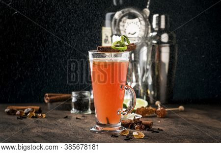 Hot Buttered Rum, Autumn Or Winter Warming Alcoholic Cocktail With Apple And Lemon Juice, Dark Rum,