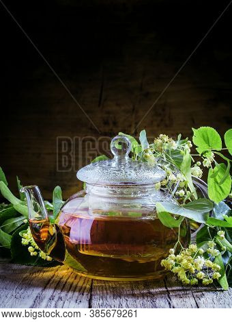 Useful Linden Tea In Glass Teapot, Branches Linden Flowers And Leaves, Vintage Wooden Background, Se