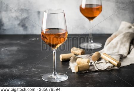 Orange Wine In Big Wine Glass, Fashionable Modern Drink, Gray Counter Background, Copy Space, Select