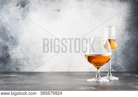 Set Of Hard Strong Alcoholic Drinks And Spirits In Glasses In Assortment: Vodka, Cognac, Brandy And