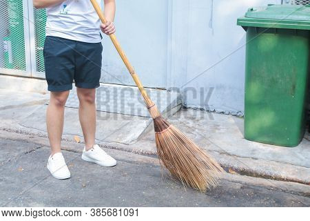 Man Using Broom Sweep The Street Or Floor Garbage Cleaning Service Concept City.maintenance Worker I