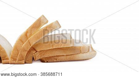 Slices Of Fresh Delicious Bread Isolated On A White Background. Close Up Image Of Cut Of Loaf Bread.