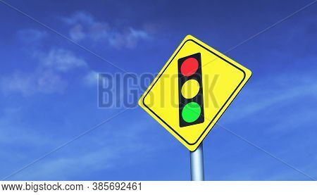 Traffic Light Road Sign On A Metal Pole, Against A Blue Sky Background