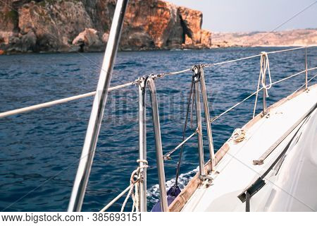 Sailing Yacht Deck With Railings And Ropes. Boat Trip At Sunny Summer Day