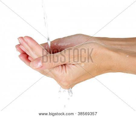 Washing hands on white background close-up