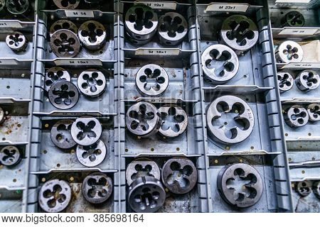 Different Size Sorted Thread Cutting Die Tool, A Photo Close Up. Industrial Abstract Background
