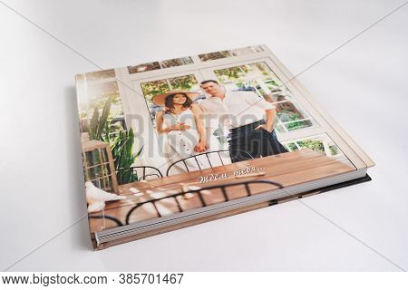 Photobook. Photo Book With Thick Pages On White Table. Convenient, Beautiful And Long-lasting Storag