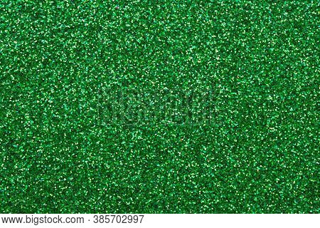 Shiny Sequin Fabric. Sparkle Green Texture, Dark Glitter Background. Shimmering Surface Of Textile.
