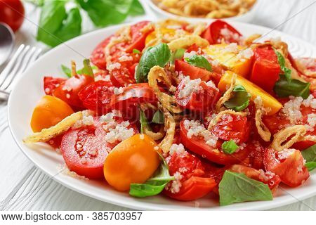 Tomato Salad With Crispy Fried Onion, Quinoa And Fresh Basil On A White Plate On A Wooden Table, Clo