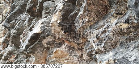Stone Rock Closeup In Sarajevo, Bosnia And Herzegovina. Ancient Frozen Lava. Layers And Strata Of Ro